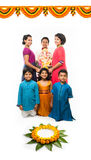 Indian Cute kids holding statue of Lord Ganesha or Ganapati on Ganesh festival or chaturthi, welcoming god. Asian small boys and g. Irls with Lord Ganesha Royalty Free Stock Image