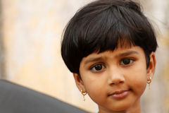 Indian cute small girl. Small indian girl during the christian ceremony Royalty Free Stock Photos