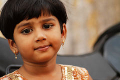 Indian cute small girl. Small indian girl during the christian ceremony Royalty Free Stock Photo