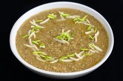 Indian dalia -bajre ki kheech. Indian sweet dalia or sour bajre ki kheech ,Milk,Saffron and nuts Stock Photo