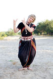 Indian dance. The woman dancer demonstrates Indian dance Stock Image