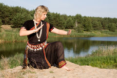 Indian dance. The woman dancer demonstrates Indian dance Stock Photos