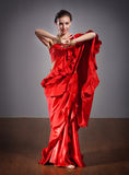 Indian dancer in red dress. Portrait of Indian dancer in red dress on grey background royalty free stock photo