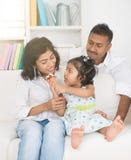 Indian daughter feeding Stock Image