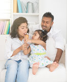 Indian daughter feeding her parents Royalty Free Stock Photo