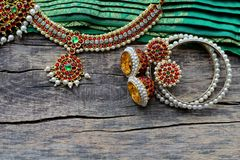 Indian decorations for dancing: bracelets, earrings, elements of the Indian classical costume for dancing bharatanatyam and stock images