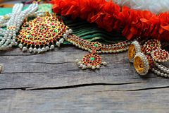 Indian decorations for dancing: bracelets, earrings, elements of the Indian classical costume for dancing bharatanatyam and stock photos