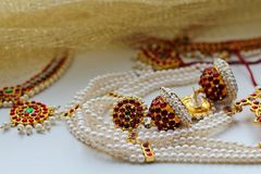 Indian decorations for dancing: earrings, gold scarf and decoration on the neck and on the head. Indian classical dance style royalty free stock image