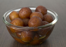 Indian delicacy sweet served in a bowl. Brown sweet balls delicacy known as Gulab Jamun fried and served in a bowl Stock Photo
