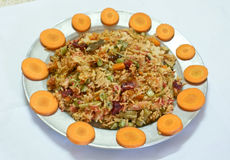 Indian delicacy - the vegetable rice pulao. Indian rice delicacy called as Vegetable Pulao beautifully garnished with coriander and decorated by carrot slices Stock Photography