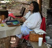 Indian Demonstration - Making Beaded Items. An Indian demonstration in Cherokee, North Carolina. This native American woman is a bead artist Royalty Free Stock Image