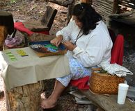 Indian Demonstration - Making Beadede Items. An Indian demonstration in Cherokee, North Carolina. This native American woman is a bead artist Royalty Free Stock Image