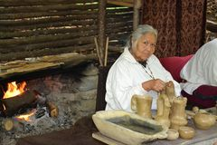 Indian Demonstration - Making Pottery. An Indian demonstration in Cherokee, North Carolina. This native American woman is a pottery artist Stock Image