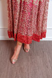 Indian designer dress. Pattern of a red flowery Indian designer dress Stock Photos