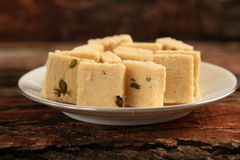 Indian dessert --Soan halwa served in plate, Stock Photography