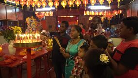 Indian devotee pray at chinese temple of Chew Jetty during deity