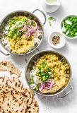 Indian dhal with jasmine rice, marinated red onion, scallion and whole grain flatbread on light background, top view. Flat lay, ve. Getarian food concept stock photo