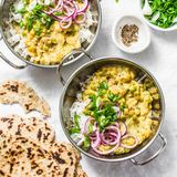 Indian dhal with jasmine rice, marinated red onion, scallion and whole grain flatbread on light background, top view. Flat lay, ve. Getarian food concept royalty free stock photos