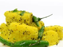 Indian dhokla on white background. Indian dhokla with green chilly and green coriander. useful in food items Royalty Free Stock Images