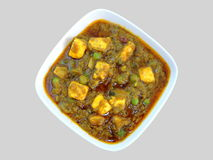 Indian dish - Matar Paneer or Paneer peas masala Royalty Free Stock Images