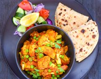 Indian meal- Gobhi aloo with roti and salad Royalty Free Stock Image