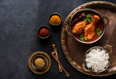 Spicy chicken legs with rice. Indian dish chicken spicy curry masala royalty free stock photos