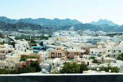 Indian district in Muscat. View from the highway of the Indian district of the city of Muscat, capital of Oman. In the background the arid mountains of Oman Royalty Free Stock Photos