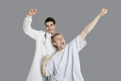 Indian doctor with an enthusiastic patient cheering up Royalty Free Stock Photo