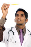 Indian doctor holding a thermometer Stock Photography