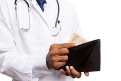 Doctor counting money in wallet stock images