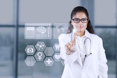 Indian doctor pressing futuristic screen Royalty Free Stock Photography