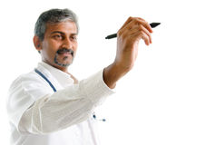 Indian doctor writing. Royalty Free Stock Image