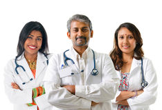 Indian doctors. Group of Indian medical doctors, male and female standing isolated on white background Royalty Free Stock Photography