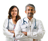 Indian doctors or medical team. Crossed arms standing isolated on white background Royalty Free Stock Photography
