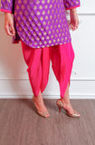 Indian dress pattern. Pattern of a purple indian dress and pink pants Royalty Free Stock Photography