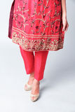 Indian designer dress. Flowery pattern of an indian designer dress and pants Royalty Free Stock Image