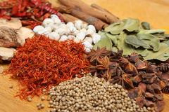 Indian Dried Spices. On a wooden chopping board Stock Photography