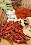 Indian Dried Spices. On a wooden chopping board Royalty Free Stock Photo