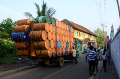 Indian drivers preparing heavily overloaded truck for travelling at Kerala Royalty Free Stock Photos