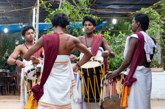 Indian drummers. KERALA, INDIA - JANUARY 15, 2016: Indian drummers playing Chenda drums during Theyyam ceremony Stock Image