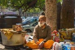 Indian elderly man sells tea on the street in Jaipur. Rajasthan. India royalty free stock photos