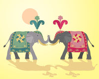 Indian elephant design. An illustration of two indian elephants in fancy ceremonial dress on a yellow background Royalty Free Stock Image