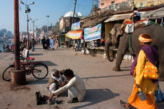 Indian elephant walking along a barber. Indian elephant walking down the street along a barber in Chitrakoot, India. Population of Chitrakoot is 22,294. By the Royalty Free Stock Image