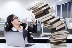 Indian employee with books in office Royalty Free Stock Images