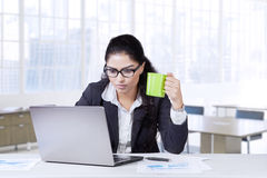 Indian employee drinks coffee while working Royalty Free Stock Photography