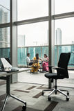 Indian employees during break on the terrace of a modern buildin Stock Photo