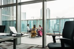 Indian employees during break on the terrace of a modern building Stock Photos