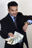 indian executive with money in hand Royalty Free Stock Images