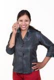 Indian executive talking over mobile casually Stock Photos