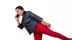 Indian executive talking over mobile casually Stock Photo